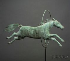 Molded Copper Horse Jumping Through Hoop Weather Vane, Attributed to A.L. Jewell & Co. Waltham, Massachusetts, 1852-1867, flattened full-body figure with embossed sheet copper mane and tail, jumping through original copper rod hoop, verdigris surface, including metal stand, ht. from copper rod just below hoop to top of hoop 17, lg. 28 1/4, total ht. with stand 75 in.     Provenance Ron and Penny Dionne.