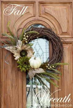 Go a more elegant route with a subtle grapevine wreath, starring only a white pumpkin.  Get the tutorial at Confessions of a Serial Do-It-Yourselfer »   - HouseBeautiful.com