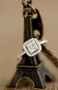 I love square engagement rings. Parisian box princess cut halo diamond engagement ring.