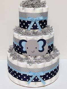 SET OF 3 - 3 Tier & 2 Mini Navy Blue and Gray Baby Boy Diaper Cake, Diaper Cakes made with Pampers Swaddlers (size 1-2) * 100% usable diapers * 3 tier cake measures 14 tall x 10 wide * 2 mini cakes measure 8 tall x 6 wide. This adorable cakes will arrive fully assembled wrapped