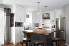 Love the white kitchen cabinets and dark gray island with butcher block. Paint Cabinets White, Grey Cabinets, White Kitchen Cabinets, Updated Kitchen, New Kitchen, Kitchen Dining, Kitchen Decor, Space Kitchen, Kitchen Ideas