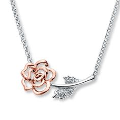 This gorgeous rose necklace blooms in 10K rose gold and sterling silver with diamond accents. The 17-inch rolo chain fastens with a spring ring clasp.
