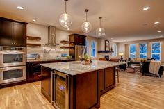 Stainless steel accents gleam in this stunning kitchen. New homes built by Bello Custom Homes in Denver, CO.