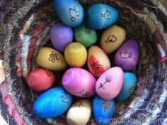 water colored wooden eggs with wood burn illustrations