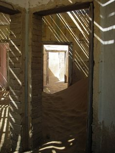 Kolmanskop is in crumbling ruins, going from grandeur to ghost houses waiting to be buried by the Namib desert.