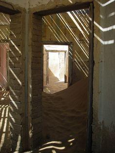 Kolmanskop is in crumbling ruins, going from grandeur to ghost houses waiting to be buried by the Namib desert.