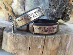Find your wings and fly, leather cuff, stamped silver metal, wings.  www.ahavadesign.com