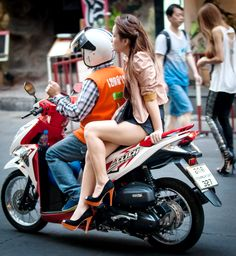 After watching and admiring the poise and balance of Thai girls riding side-saddle on motorbikes for over 14 years, it dawned on me...... Why do they ride this way? Much more about Koh Samui and Thailand here: http://islandinfokohsamui.com/