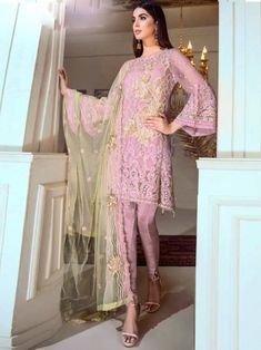 Graceful pink partywear straight cut suit online which is crafted from georgette fabric with exclusive embroidery work. This stunning designer straight cut suit comes with santoon bottom and net with heay work dupatta. Manish Malhotra Salwar Kameez, Indian Dresses, Indian Outfits, Heavy Dupatta, Mehndi Outfit, Salwar Kameez Online Shopping, Women's A Line Dresses, Bollywood Dress, Pakistani Suits