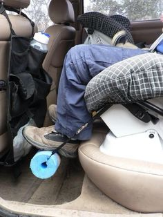 Footrest for forward facing kids that kick your seat or complain about their legs dangling. Tech approved! It's a pool noodle attached with a strap or rope through the rear facing belt path of a convertible car seat.