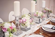thick crystal candlesticks and mirrored glass cubes make this tabletop LUXE (imagine how different it would be using the same flowers in wooden boxes and aged brass candlesticks instead) // Photography: Vasia Weddings Event Design + Planning: Lé Soirées Weddings & Events Floral Design: The Flower Factory