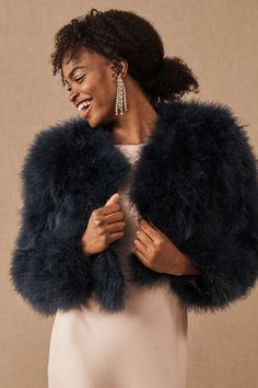 Seeking the perfect topper for a winter wedding? Cozy up to this glam faux fur jacket!