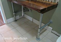 Industrial vanity legs with rustic 2x6 wood board top. Stunning and cost-effective!