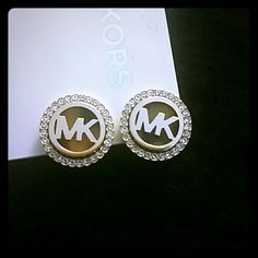 Michael Kors Earrings NWT, gorgeous silver clip on earrings. Subtle tortoise pattern behind MK. Beautiful, would make a great gift! Offers welcomed! Michael Kors Jewelry Earrings