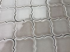 """Dove Gray Arabesque Porcelain Tile available online from thebuilderdepot.com for under $10.00 a square foot this incredible mosaic comes with matching 3x6"""", chair rail and quarter round trims."""