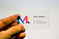 newly designed and assembled business card. Homemade out of acrylic and matte adhesive transparent paper.