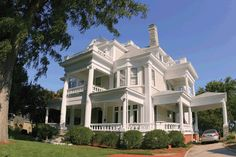 The Berryman Mansion. The Mansion, Circa 1900, is one of the most impressive homes of the Victorian period. It features a ballroom on the third floor, a widow's walk at its peak and an ornate gazebo overlooking the Pagan River.