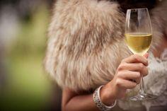 Fur, bracelet & wine