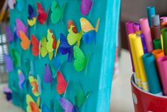 Beautiful butterfly painting - I did similar one with flowers punched with paper punch from diffusion paper