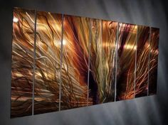 Extreme Blaze Metal Wall Art. This 7 panel metal wall sculpture by artist Ash Carl will mesmerize you and your guests! Artist Ash Carl creates hand-sanded patterns on metal that are then painted to create the most incredible hologram effects as seen in this Extreme Blaze Metal Wall Art.