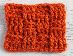close up of crochet basketweave swatch in orange yarn