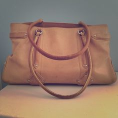 Beautiful large vintage satchel! Rare, vintage Cole Haan bag!  Beautiful camel color goes with everything and all seasons. Feminine pink lining with lots of pockets...snap for keys, snap pocket for cell phone. Some wear on leather straps and a little discoloring inside on floor of liner. Cole Haan Bags Satchels