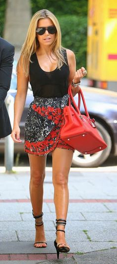 Street style | Black cami, embroidered floral skirt, strapped heels, red handbag