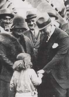 Ataturk loving a child with Afet İnan, Dortyol trip, Feb.15, 1931