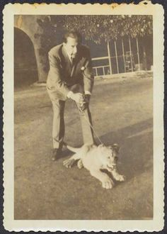 J. Paul Getty with lioness cub Teresa at the Getty Villa