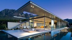 First Crescent Project in Camp Bay, South Africa:  A minimalist home, commanding a 270 degree view of Lions Head, Camps Bay and the Atlantic Ocean.  The living spaces of this home are highly transparent to take full advantage of these views.