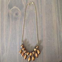 Statement Necklace Fun Amber colored 'disco ball' like necklace. The perfect piece to add some glitz to a dress for a fun event! Jewelry Necklaces