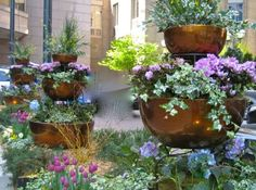Three tiered garden containers mix well within a traditional garden design to add points of visual interest. Full Sun Container Plants, Container Gardening, Small City Garden, Small Gardens, Backyard Garden Landscape, Fence Garden, Garden Bed, Corner Garden, Large Backyard