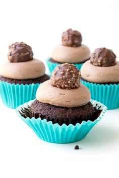 OH my word! These Nutella Stuffed Chocolate Cupcakes are incredible! Creamy Nutella frosting topped with a Ferrero Rocher - YUM! Recipe from sweetestmenu.com #cupcakes #chocolate #nutella #choc #baking