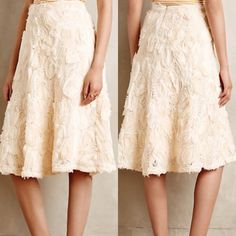 """Anthropologie tufted blossom midi skirt Polyester rayon spandex lining. A line silhouette. Dimensional floral appliqué. Back zip. 26"""" L Anthropologie Skirts Midi"""