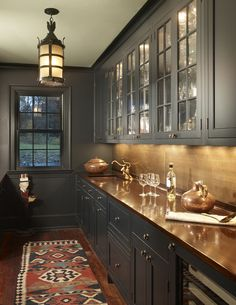 Love this moody and masculine butler's pantry in a Virginia hunt country home by Barnes Vanze architects.