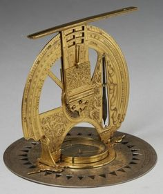 """Theodolite. Bavaria, 16th century. Gilt and silvered brass, partly enamelled. Signed and dated """"HOC OPVS FECIT VDVLRICVS SCHNIEP DE MONACO ANNO *1566*"""" [This work is made by Ulrich Schniep of Munich in the year 1566]. Circular base with compass and a foldable, hinged dial and alidade, combined with sundials. Richly engraved with scales, zodiacal signs, city names and fretwork. Height in total: 13‑17 cm. Diameter: 15 cm."""