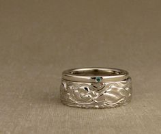 14K carved wedding band + emerald band