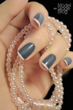 Grey and white/nude French manicure nails.