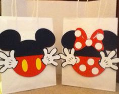 These sturdy goody bags are a festive choice for any occasion! The silhouette of the Minnie Mouse head and tiny bow (embellishments with rhinestone) are made with felt or foam .  Each bag measures 5¼x2¾x8½H with twist handles.  Price included Personalized tags.  The price list is per 6 bags.  NOTE: When placing your order be sure to write the name of the honored person, kind event and date.