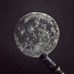 Full 🌕 drawing on black paper.