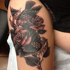 black and grey birds and roses done by Winsor at Adrenaline Toronto