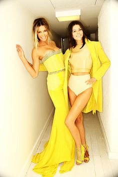 Love the long yellow dress on the left omgooodness...<3