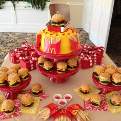 My aunt made this, she is so talented! Mcdonald's cake and cupcakes. I made the burgers out of brownies and cupcakes for the buns. The fries are made from sugar cookies. Yummy!