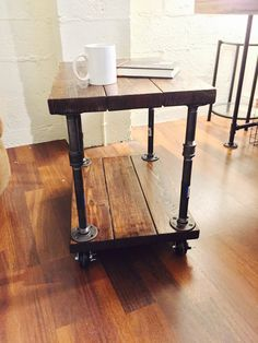 Reclaimed Industrial style side or coffee table with pipe base and full swivel casters made custom to your order! NOW 30% OFF by NOLAWoodworking on Etsy https://www.etsy.com/listing/236439863/reclaimed-industrial-style-side-or