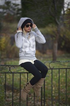 cute, cozy, comfy, and casual winter time outfit - black leggings, light brown boots, long grey hoodie with black hoodie underneath and big sunglasses. My kinda style!