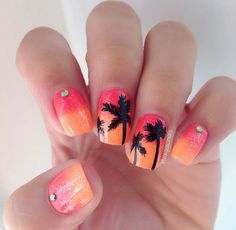Do you want to bring in the summer sunset with you? If you want to, then this nail art design is perfect for you. Salmon and yellow orange hues combined to reveal a sunset-ish gradient is coated over your nails. Topped with black silhouettes of coconut trees resembling their shadows during the setting sun. It simply makes you feel warm and at home in the summer.