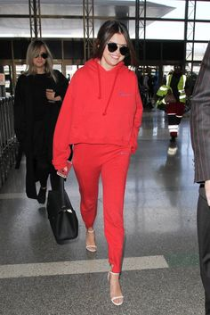 Before Selena boarded a plane in a red Vetements set and white sandals, we thought pairing loungewear with ...