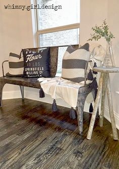 """Adding a few cable-knit pillows from Home Goods was the perfect way to bring in warmth and texture to this metal bench in our breakfast nook!  The glass """"beaker"""" vase from Home Goods adds an unexpected  industrial touch! {Sponsored Pin}"""