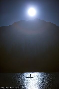 Zizka, from Alberta, Canada, said: 'It was an incredibly still, clear night - the stars danced across the surface of Goat Pond in Kananaskis, making it seem like I was paddling through the night sky' (BLISS)
