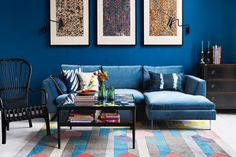 living room with blue sections sofa and blue walls